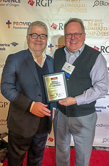 Scott Madsen, SIOR and Jeff Falconer, SIOR proudly showing off the 2017 Oregon's Most Admired Companies Plaque